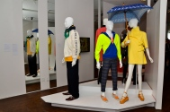 From Left to Right: David Chu (Nautica men's day ensemble, 1990s: White cotton/nylon sailing anorak, yellow branded fleece, navy cotton corduroy pants, brown leather boat shoes), Humberto Leon and Carol Lim (Men's day ensemble, Spring/Summer 2008: Lime and blue cotton hooded sweatshirt, ACT UP cotton T-shirt, striped cotton pants, orange Timberland collaboration sport shoes. Women's day ensemble: Lemon cotton flare coat, spring/Summer 2006; yellow patent Robert Clergerie collaboration sandal platform, Spring/Summer 2011: square Guy de Jean collaboration umbrella, 2011)