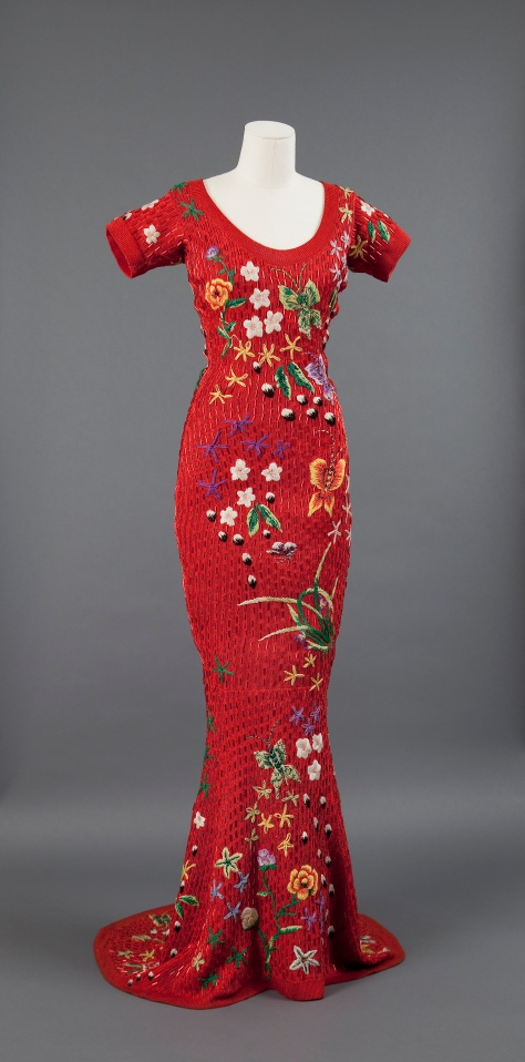 Zang Toi, Chinese Folk Art-Inspired Lacquered Red Knit Gown with Hand-beaded Flowers and Butterflies, Spring 1991, photograph courtesy of Museum of Chinese in America